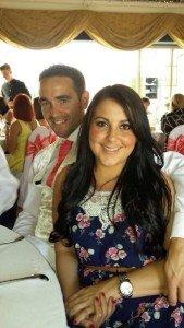 Danielle and Richard seated at friends wedding